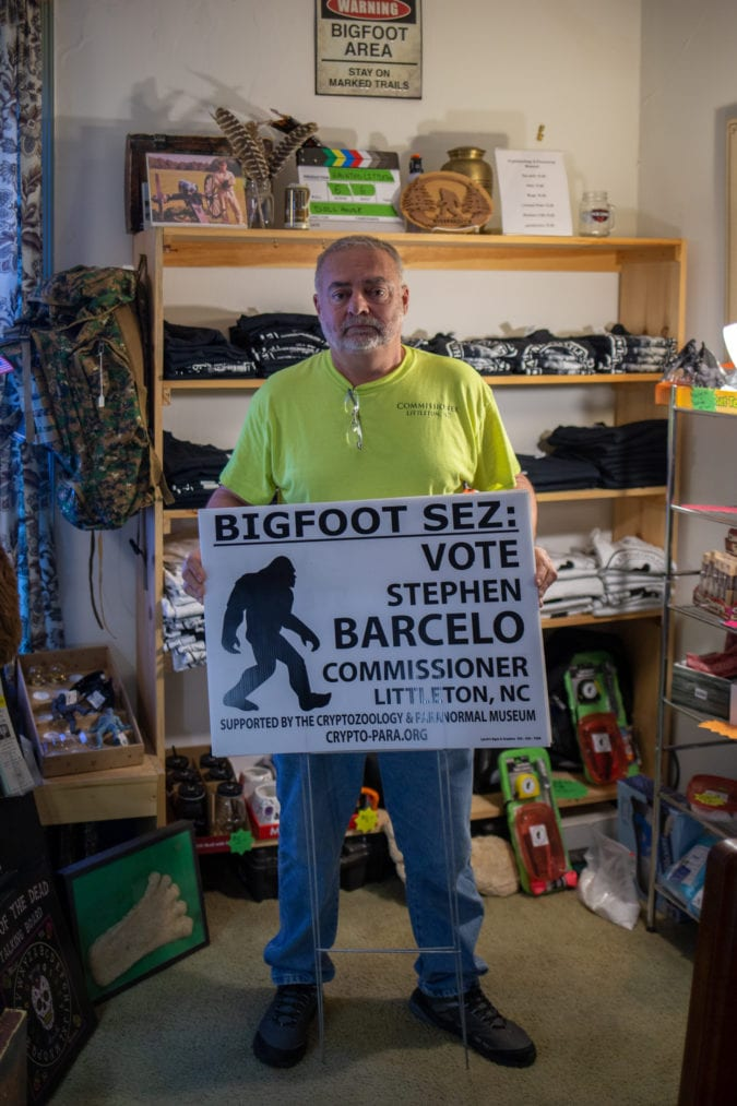 Stephen Barcelo with his yard sign.