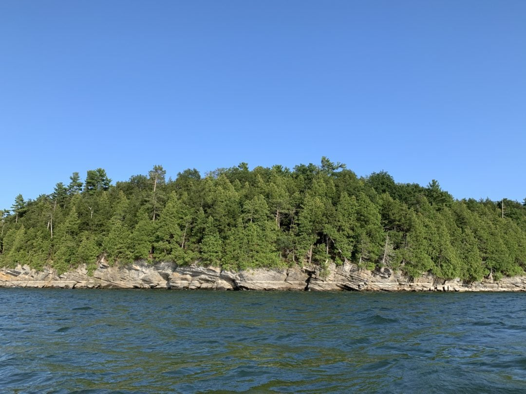 Craggy shores of Vermont dipping into the glacial waters of Lake Champlain