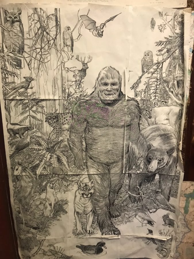 A drawing of bigfoot in the woods