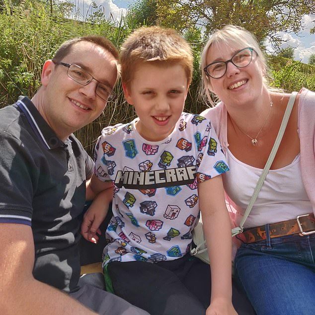 Beckie Melvin with her husband Paul and son Cameron: 'Being home has definitely influenced when our ghost makes himself heard,' she says