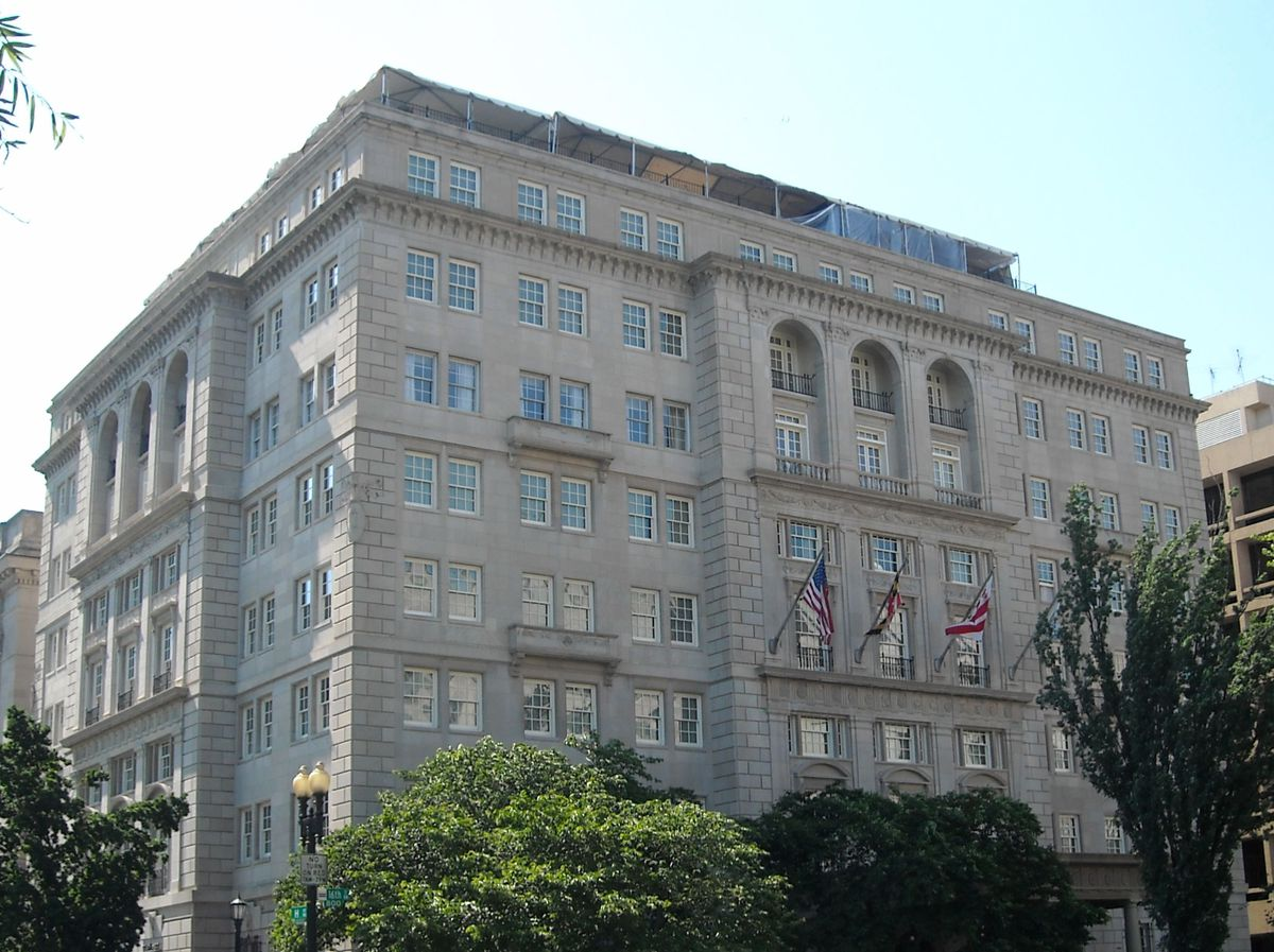 The exterior of the Hay-Adams Hotel in Washington. The facade is tan and there are multiple windows.
