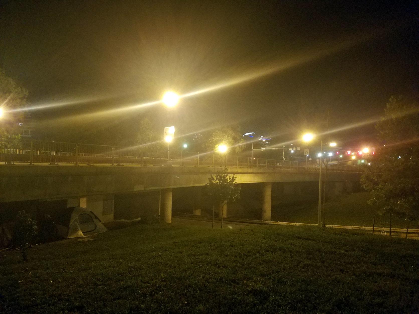 Tents under the K Street Bridge. (WTOP/Will Vitka)