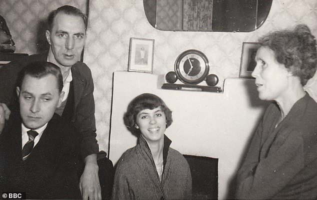 Spooky goings on: The Hitchings family in the front room of the property in 1957